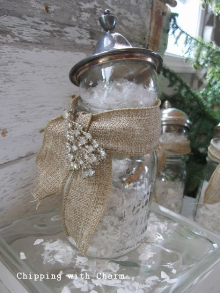 Canning jars made into snow globes filled with fake snow, and little heart oranaments, topped with a silver sugar bowl top to finish